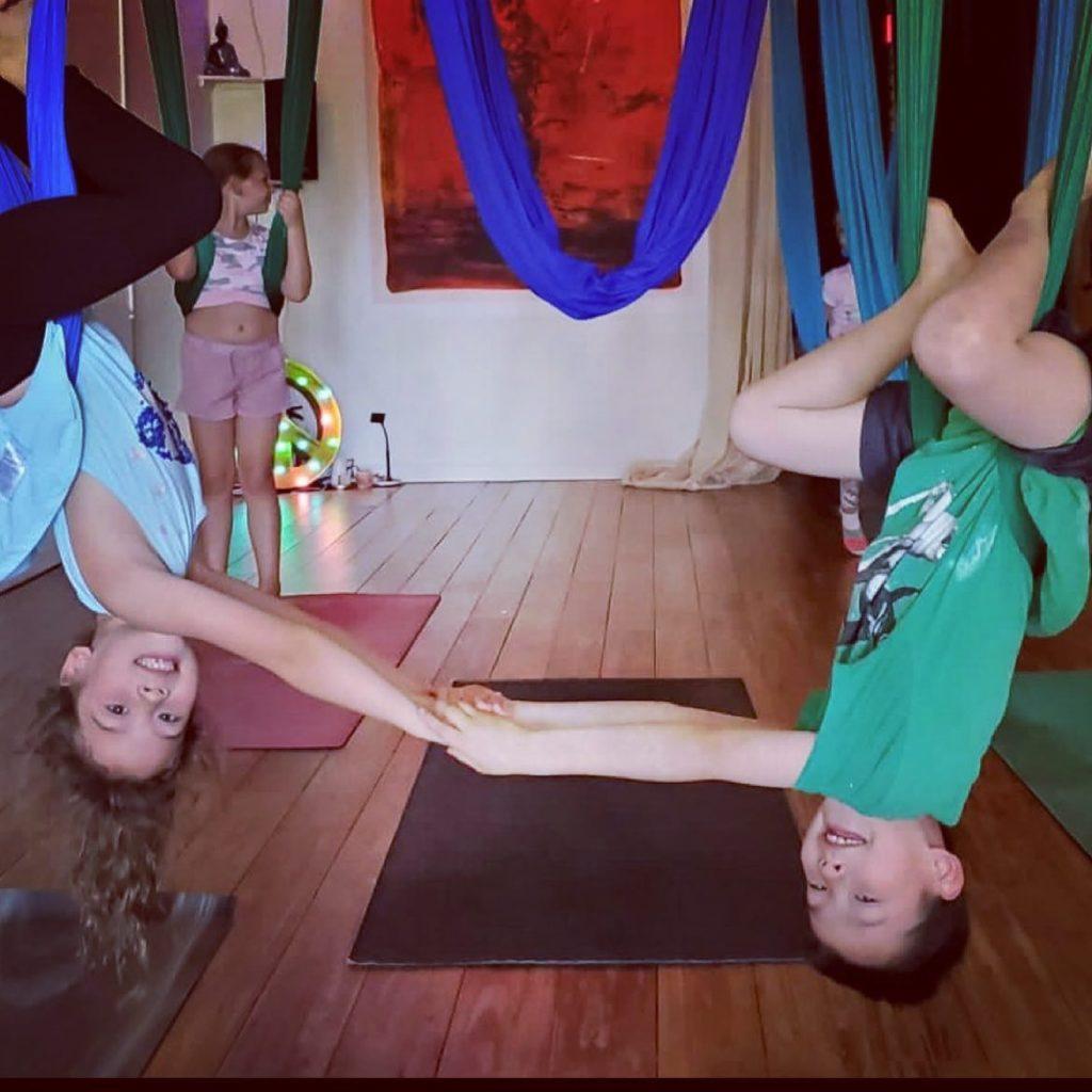 Yoga creates children who are bright lights in this world, increasing their self awareness and strength in their bodies. - Shakta Khalsa . Regram @smile_mamayogi 🐝🦋🌈✨✨✨✨✨✨ Kids Aerial Yoga Classes (Tuesdays and Fridays) with @gracehanapark  . . . . Sibling Love pictured here 🤍🤍 .  #austinyogacommunity #yingyoga #yinyang #atx #austinyoga #cedarpark #keepitlocal #nonfussy #movementismedicine #asana #practice #loveyourself #selflove #downdog #sunsalutation #ashtanga #hatha #breathe #inhale #exhale #love #peace #keepaustinfit #community #flyyoga #beherenow #meetmeonthemat #yinyang #aerialyoga #kidsaerialyoga #flyyoga